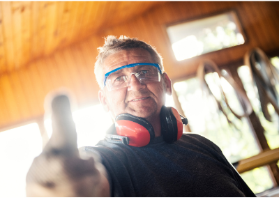 Man with safety glasses and ear muffs