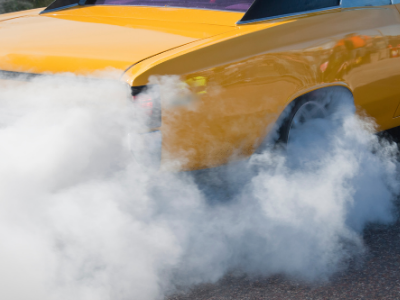 Yellow car doing a burnout