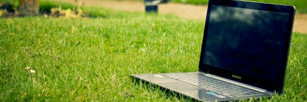 Laptop on Lawn - Workplace Wellness